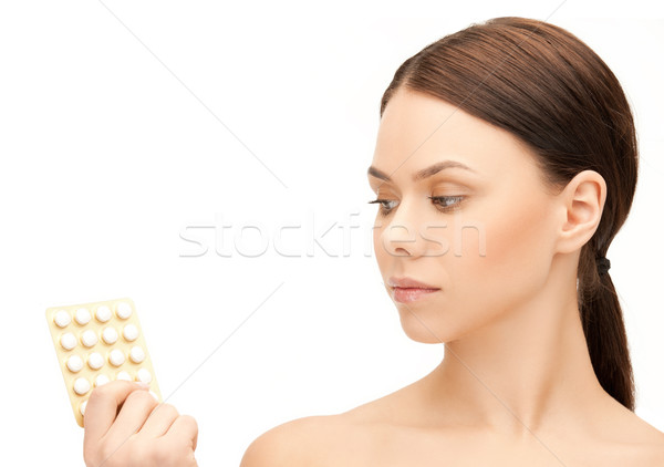 young woman with pills Stock photo © dolgachov
