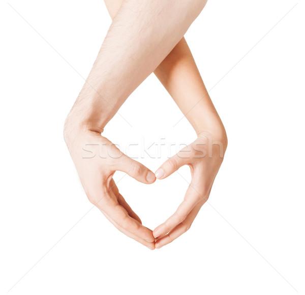 Kadın adam eller kalp şekli Stok fotoğraf © dolgachov