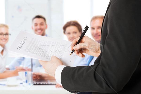 man signing contract Stock photo © dolgachov