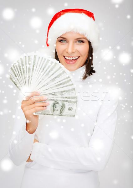woman in santa helper hat with us dollar money Stock photo © dolgachov