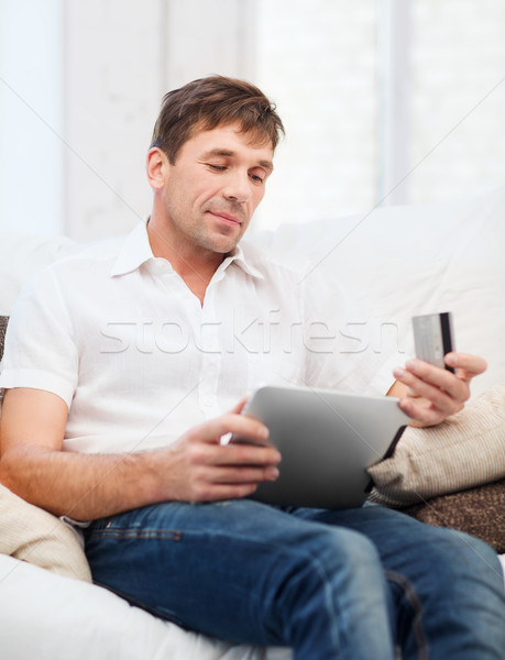 man with tablet pc and credit card at home Stock photo © dolgachov