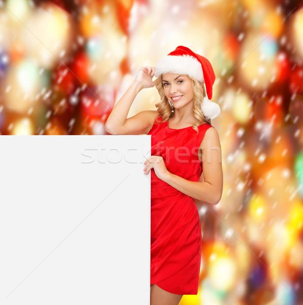 woman in santa helper hat with blank white board Stock photo © dolgachov