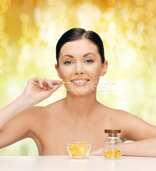 красивая женщина Омега-3 Витамины здравоохранения красоту женщину Сток-фото © dolgachov