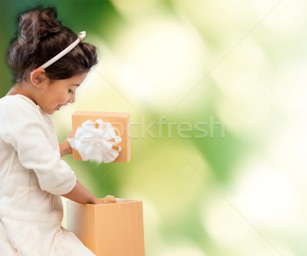 happy child girl with gift box Stock photo © dolgachov