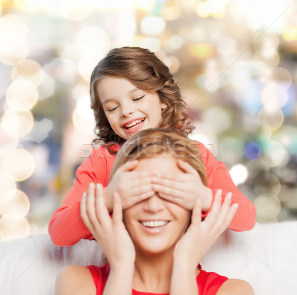 smiling mother and daughter making a joke Stock photo © dolgachov