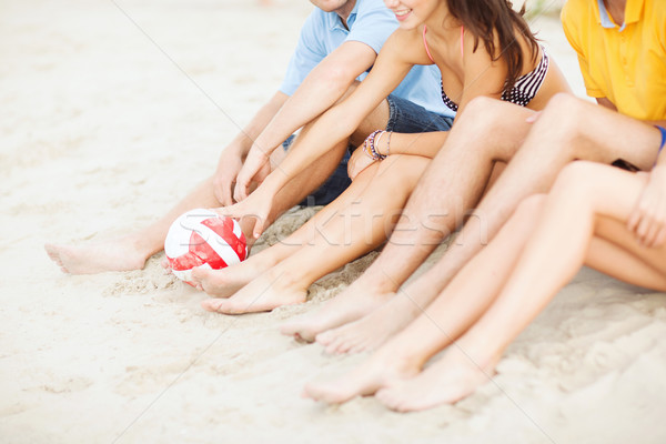 teenager friends or volleyball team having fun Stock photo © dolgachov