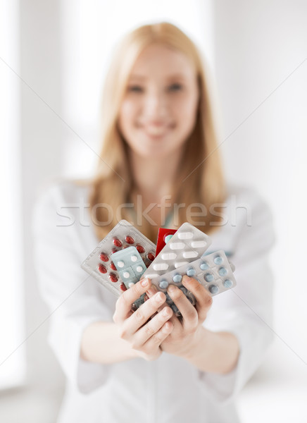 female doctor with packs of pills Stock photo © dolgachov