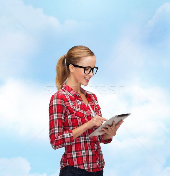 Mosolyog lány szemüveg táblagép számítógép technológia Stock fotó © dolgachov
