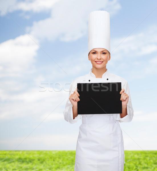笑みを浮かべて 女性 シェフ 黒 白紙 料理 ストックフォト © dolgachov