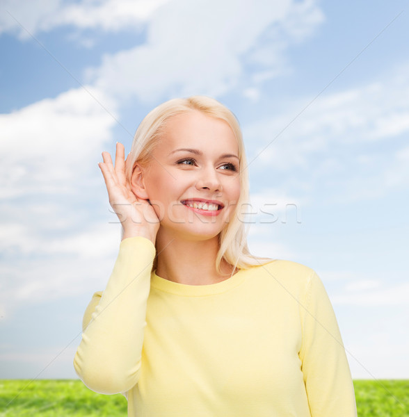 Stock photo: smiling young woman listening to gossip