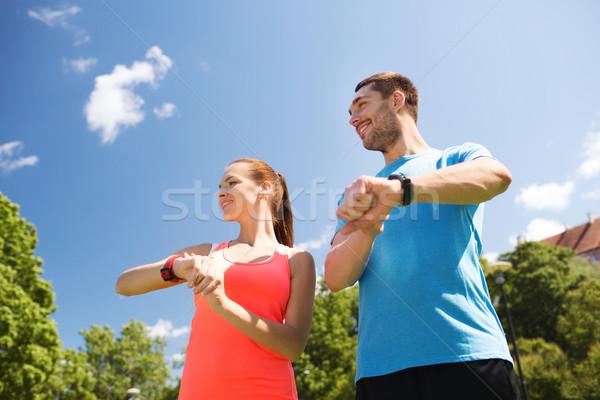 улыбаясь люди частота сердечных сокращений улице фитнес спорт Сток-фото © dolgachov