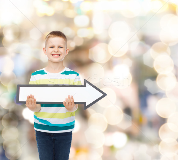 Stock photo: smiling little boy with blank arrow pointing right