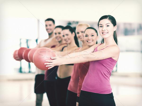 Csoport mosolyog emberek dolgoznak ki labda fitnessz Stock fotó © dolgachov