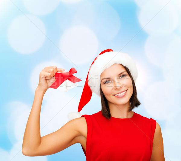 smiling woman in santa hat with jingle bells Stock photo © dolgachov