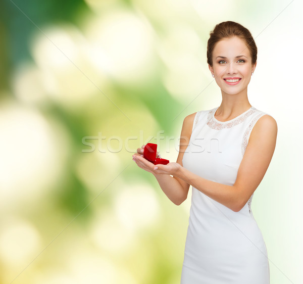 Stock photo: smiling woman holding red gift box with ring