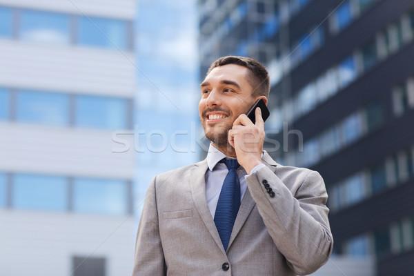 Sorridere imprenditore smartphone esterna business tecnologia Foto d'archivio © dolgachov