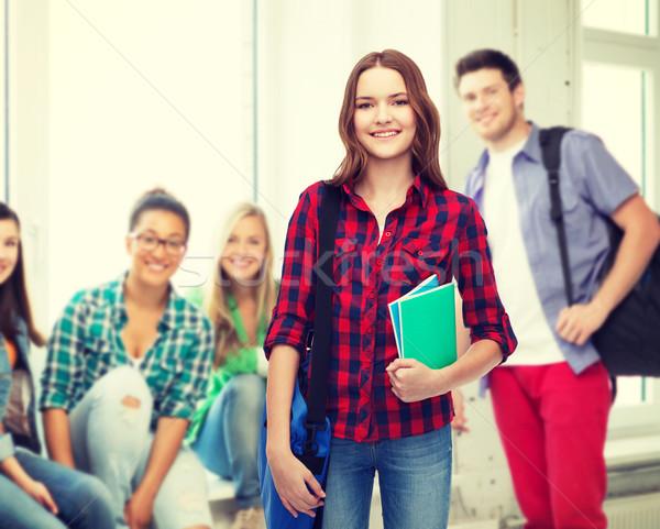 Glimlachend vrouwelijke student zak notebooks onderwijs Stockfoto © dolgachov