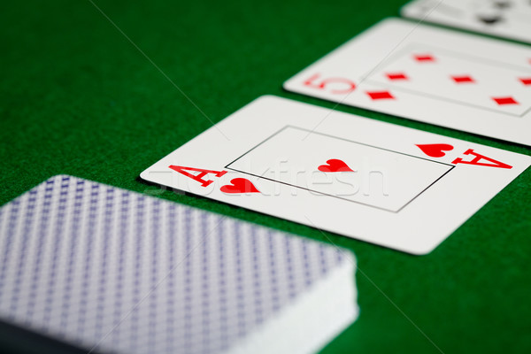 close up of playing cards on green table surface Stock photo © dolgachov