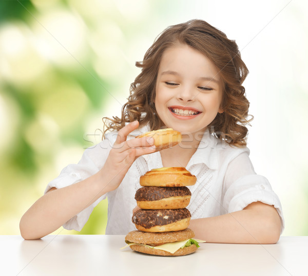 happy smiling girl with junk food Stock photo © dolgachov