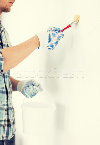 man with paintbrush and pot Stock photo © dolgachov