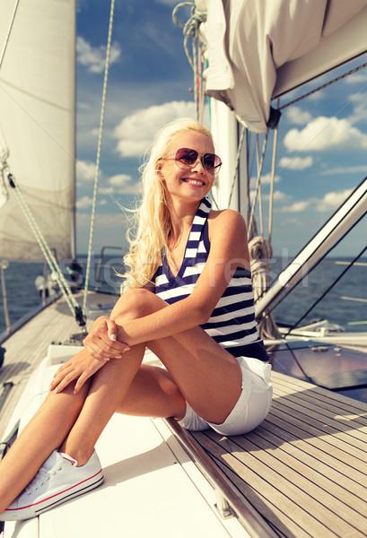 Sorridere seduta yacht deck vacanze Foto d'archivio © dolgachov