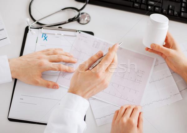 two doctors prescribing medication Stock photo © dolgachov