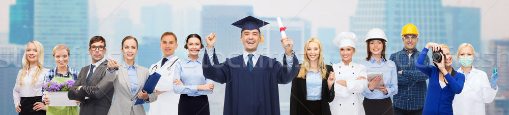 happy bachelor with diploma over professionals Stock photo © dolgachov