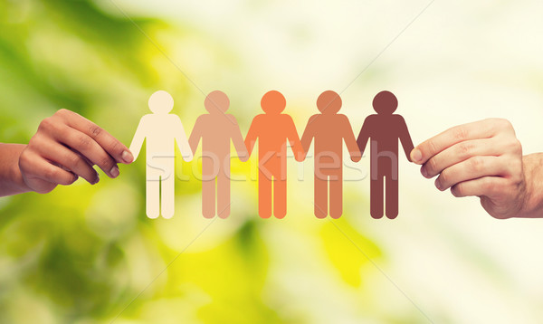 hands holding paper chain multiracial people Stock photo © dolgachov