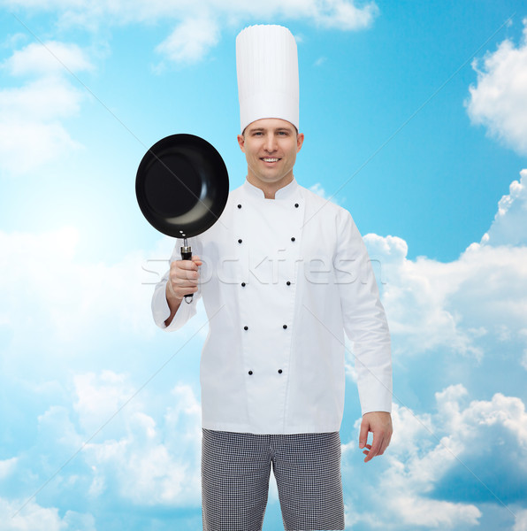 Boldog férfi szakács szakács tart serpenyő Stock fotó © dolgachov