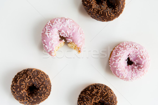 Stock photo: close up of glazed donuts pile over white