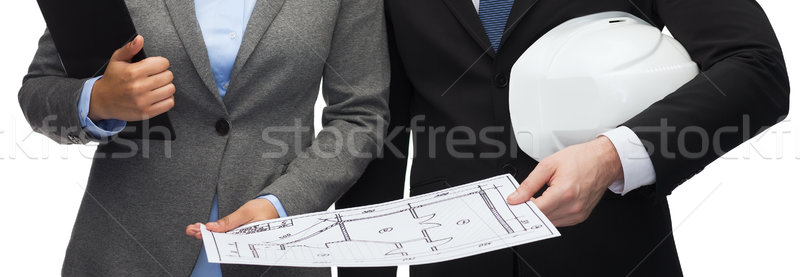 businesspeople with blueprint and helmet Stock photo © dolgachov