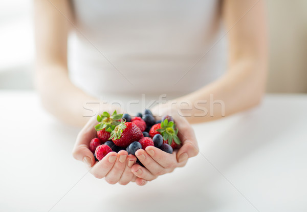 close up of woman hands holding berries Stock photo © dolgachov