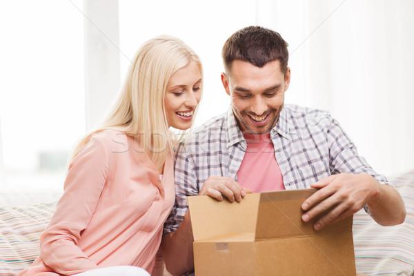 happy couple with parcel box at home Stock photo © dolgachov
