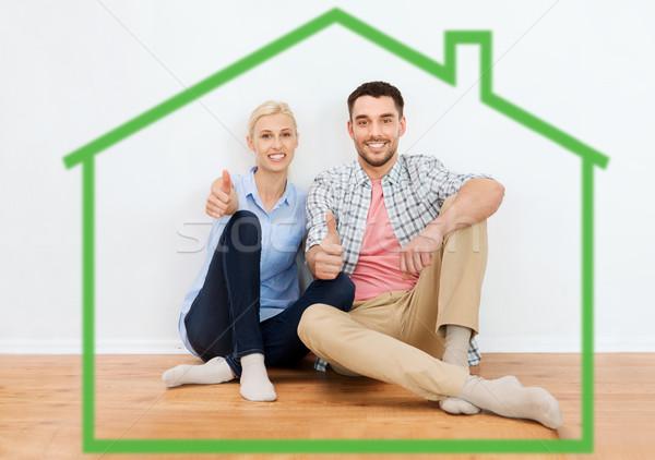 Gelukkig paar tonen nieuw huis home Stockfoto © dolgachov