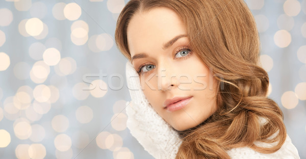 young woman in mitten over blue lights Stock photo © dolgachov