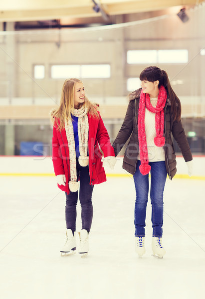 happy girls friends on skating rink Stock photo © dolgachov