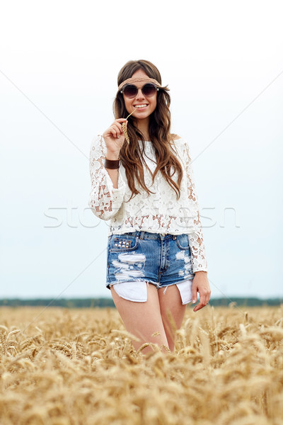 smiling young hippie woman on cereal field Stock photo © dolgachov
