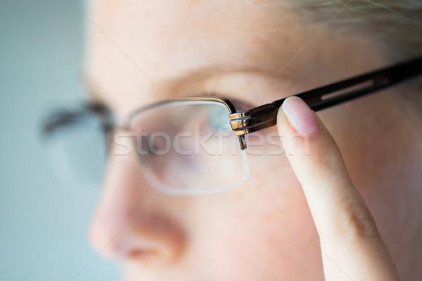close up of woman in eyeglasses Stock photo © dolgachov