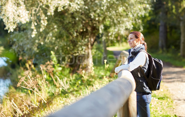 happy woman with backpack outdoors Stock photo © dolgachov