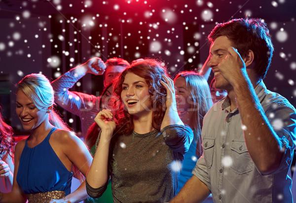 группа счастливым друзей танцы ночной клуб Новый год Сток-фото © dolgachov