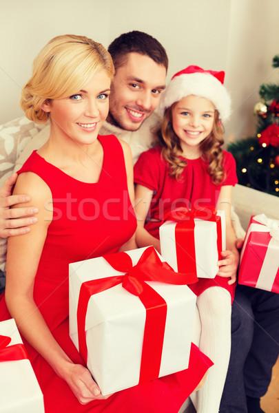 smiling family holding many gift boxes Stock photo © dolgachov