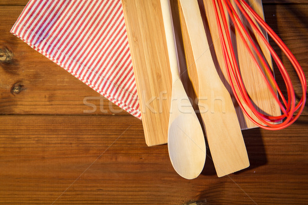 close up of cooking kitchenware on wooden board Stock photo © dolgachov