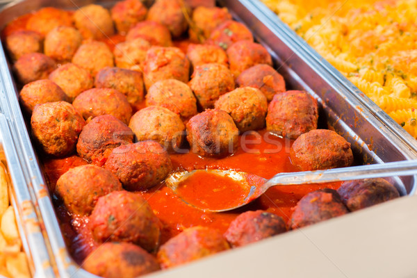 close up of meatballs and other dishes on tray Stock photo © dolgachov