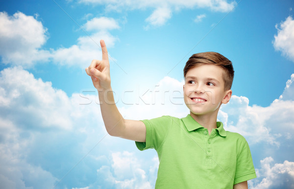 happy boy in green polo t-shirt pointing finger up Stock photo © dolgachov