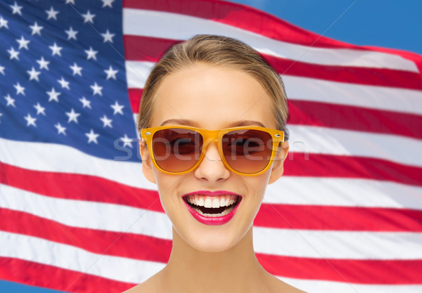 happy young woman in sunglasses over american flag Stock photo © dolgachov