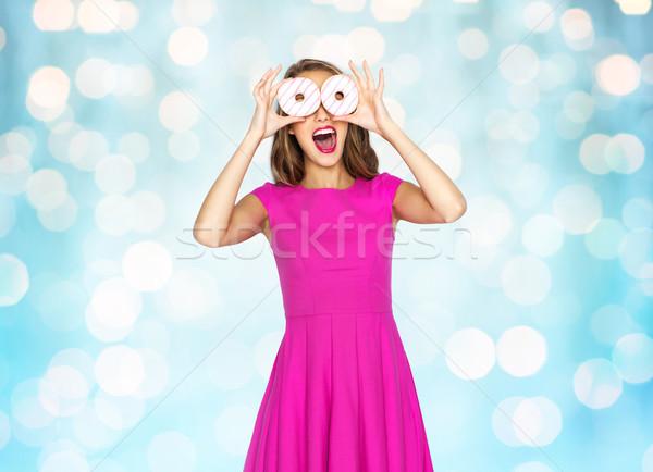 happy woman or teen girl having fun with donuts Stock photo © dolgachov