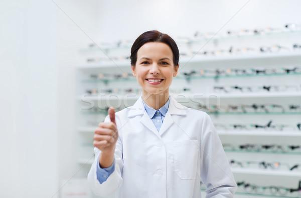 Mujer gafas óptica tienda Foto stock © dolgachov