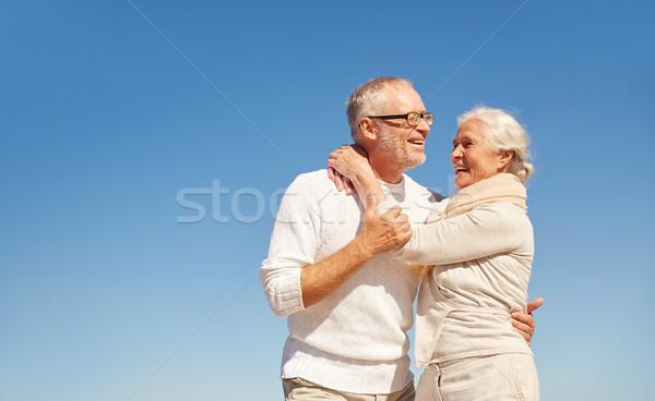 happy senior couple hugging outdoors Stock photo © dolgachov