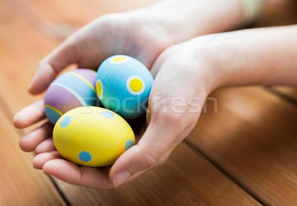 Közelkép nő kezek színes húsvéti tojások húsvét Stock fotó © dolgachov