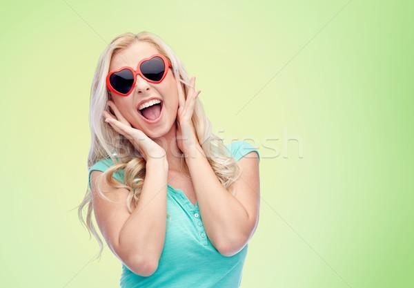 Felice a forma di cuore occhiali da sole emozioni espressioni Foto d'archivio © dolgachov